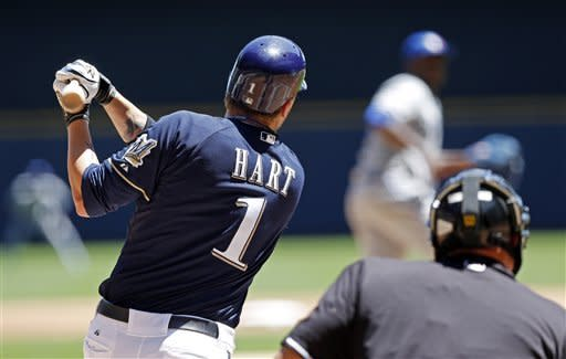 Milwaukee Brewers' Corey Hart hits a solo home run off of Toronto Blue Jays' Joel Carreno during the second inning of a baseball game, Wednesday, June 20, 2012, in Milwaukee. (AP Photo/Tom Lynn)