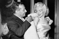"""<p>Ciro's restaurant owner Herman Hover helps into Marilyn into her coat in 1957. The restaurant and club was a famous spot for movie people in the '40s and '50s — a """"place to be seen,"""" if you will. Marilyn was just one of the many celebrities at the time who frequented Ciro's. Humphrey Bogart, Lauren Bacall, Frank Sinatra, James Dean, Ava Gardner, Lucille Ball and Desi Arnaz did too. </p>"""