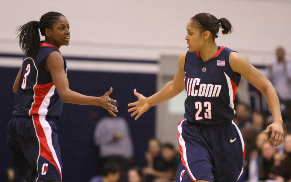 FILE - In this Jan. 31, 2009, file photo, Connecticut's Maya Moore (23) is congratulated by Tiffany Hayes after scoring against Georgetown during the second half of an NCAA college basketball game in Washington. Renee Montgomery and Hayes appreciated what former UConn teammate Moore was doing when the All-Star forward stepped away from basketball two years ago to focus on criminal justice reform. The Atlanta Dream guards admit they weren't sure why she couldn't continue keep playing at the same time. Now they have a better understanding. (AP Photo/Luis M. Alvarez, File)