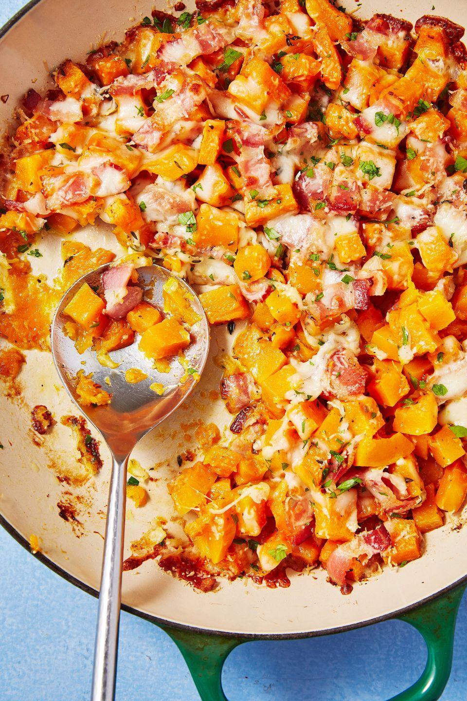 "<p>No matter what the centerpiece of your meal is, this cheesy squash skillet is sure to steal the show.</p><p>Get the recipe from <a href=""https://www.delish.com/cooking/recipe-ideas/recipes/a56379/cheesy-bacon-butternut-squash-recipe/"" rel=""nofollow noopener"" target=""_blank"" data-ylk=""slk:Delish"" class=""link rapid-noclick-resp"">Delish</a>.</p>"