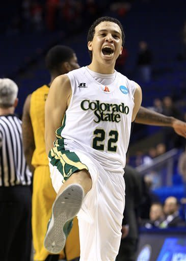 Colorado State guard Dorian Green (22) reacts as time expires in their 84-72 victory over Missouri in a second-round NCAA college basketball tournament game, Thursday, March 21, 2013, in Lexington, Ky. (AP Photo/James Crisp)