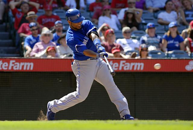 Toronto Blue Jays' Edwin Encarnacion hits an RBI single during the ninth inning of their baseball game against the Los Angeles Angels, Sunday, Aug. 4, 2013, in Anaheim, Calif. (AP Photo/Mark J. Terrill)
