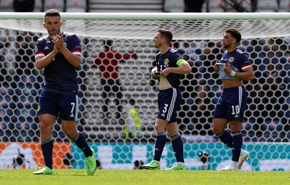John McGinn (left) feels he let the Tartan Army down with Monday's defeat (PA Wire)