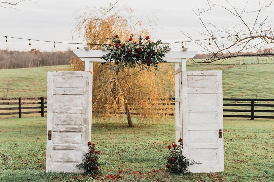 """<p>If you want your <a class=""""link rapid-noclick-resp"""" href=""""https://www.popsugar.com/latest/Wedding"""" rel=""""nofollow noopener"""" target=""""_blank"""" data-ylk=""""slk:wedding"""">wedding</a> to feel rustic, we suggest re-creating a similar version of this ceremony arch. To do so, prop up two doors against the arch, add flowers, and watch as everyone falls in love with your creative idea.</p>"""