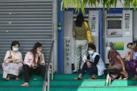 People in Myanmar have been queueing anxiously at banks after the coup as a strict new limit on daily withdrawals fuelled rumours of a money shortage