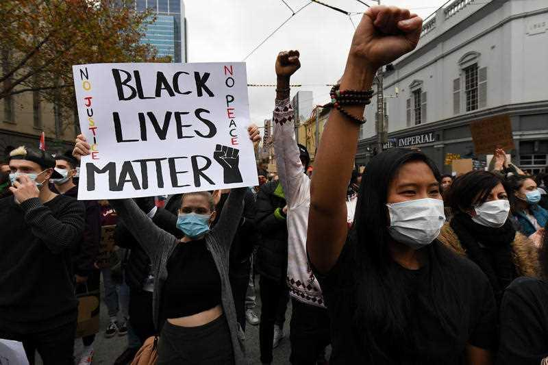 Protesters are seen during a Black Lives Matter rally in Melbourne.