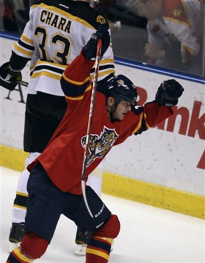 Florida Panthers' John Madden celebrates after scoring the fourth Panthers goal during the second period of an NHL hockey game against the Boston Bruins in Sunrise, Fla., Thursday, March 15, 2012. (AP Photo/J Pat Carter)