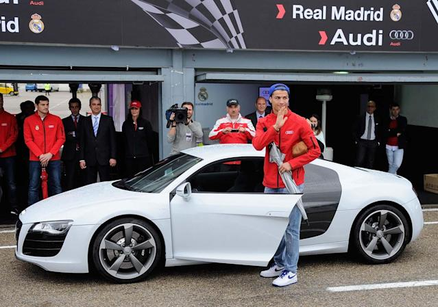 MADRID, SPAIN - NOVEMBER 08: Real Madrid player Cristiano Ronaldo receives a new Audi at the Jarama recetrack on November 8, 2012 in Madrid, Spain. (Photo by Fotonoticias/WireImage)