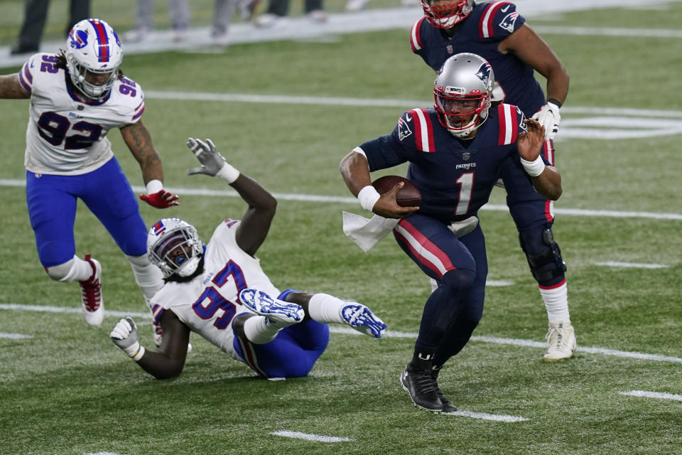 New England Patriots quarterback Cam Newton (1) runs from Buffalo Bills defensive ends Darryl Johnson (92) and Mario Addison (97) on his way to a touchdown. (AP Photo/Elise Amendola)