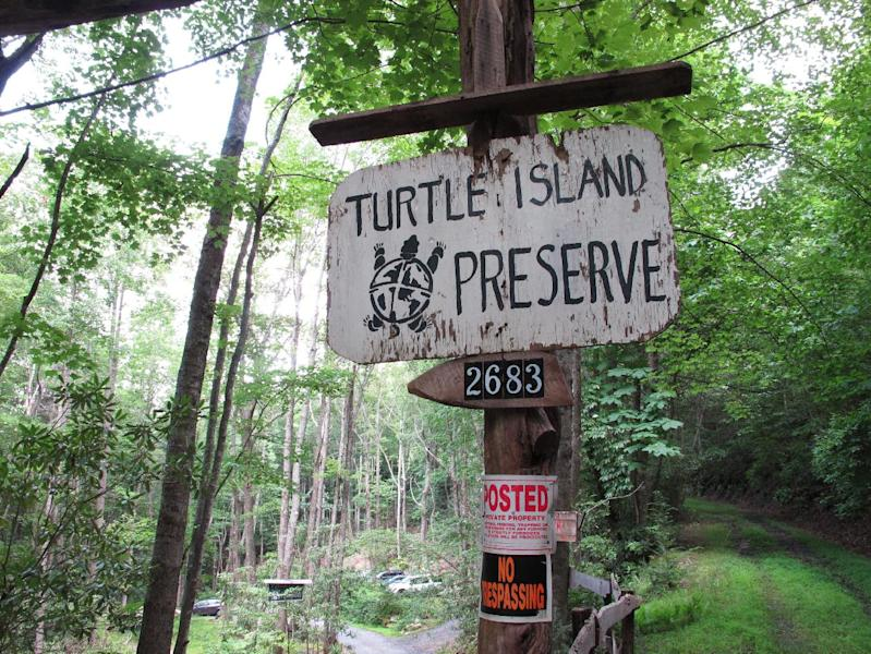 No trespassing signs are posted at the entrance to Turtle Island Preserve in Triplett, N.C., on Thursday, June 27, 2013. Turtle Island lies near the Tennessee border, just a few miles east of Boone, N.C., a county seat of 17,000 residents whose population doubles when Appalachian State University, owner Eustace Conway's alma mater, is in session. (AP Photo/Allen Breed)
