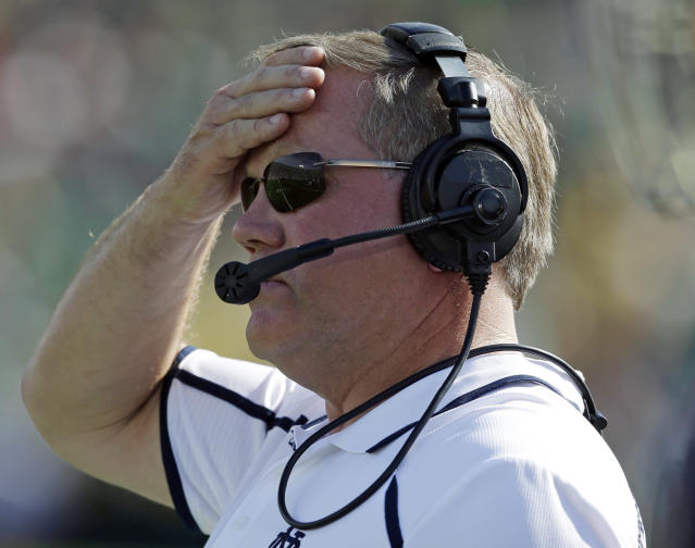 Notre Dame head coach Brian Kelly watches during the first half of an NCAA college football game against Oklahoma, Saturday, Sept. 28, 2013, in South Bend, Ind. (AP Photo/Darron Cummings)