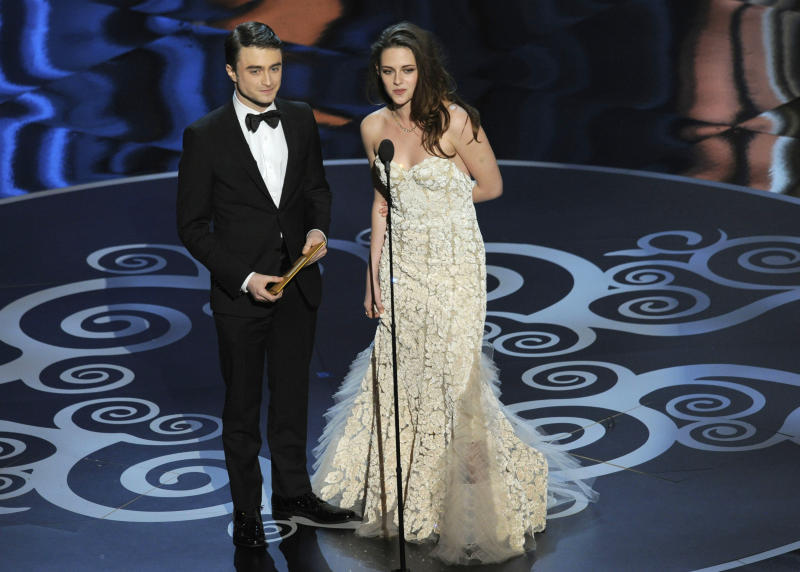 Actors Daniel Radcliffe, left, and Kristen Stewart present an award during the Oscars at the Dolby Theatre on Sunday Feb. 24, 2013, in Los Angeles. (Photo by Chris Pizzello/Invision/AP)