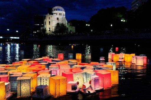 "Paper lanterns to mourn victims of the World War II atomic bombs float in the Motoyasu River in front of the Atomic Bomb Dome (in background) in Hiroshima in 2011. A grandson of former US president Harry Truman, who authorised the atomic bombing of Japan during World War II, met survivors in Tokyo Friday, calling it ""a good first step towards healing old wounds"""