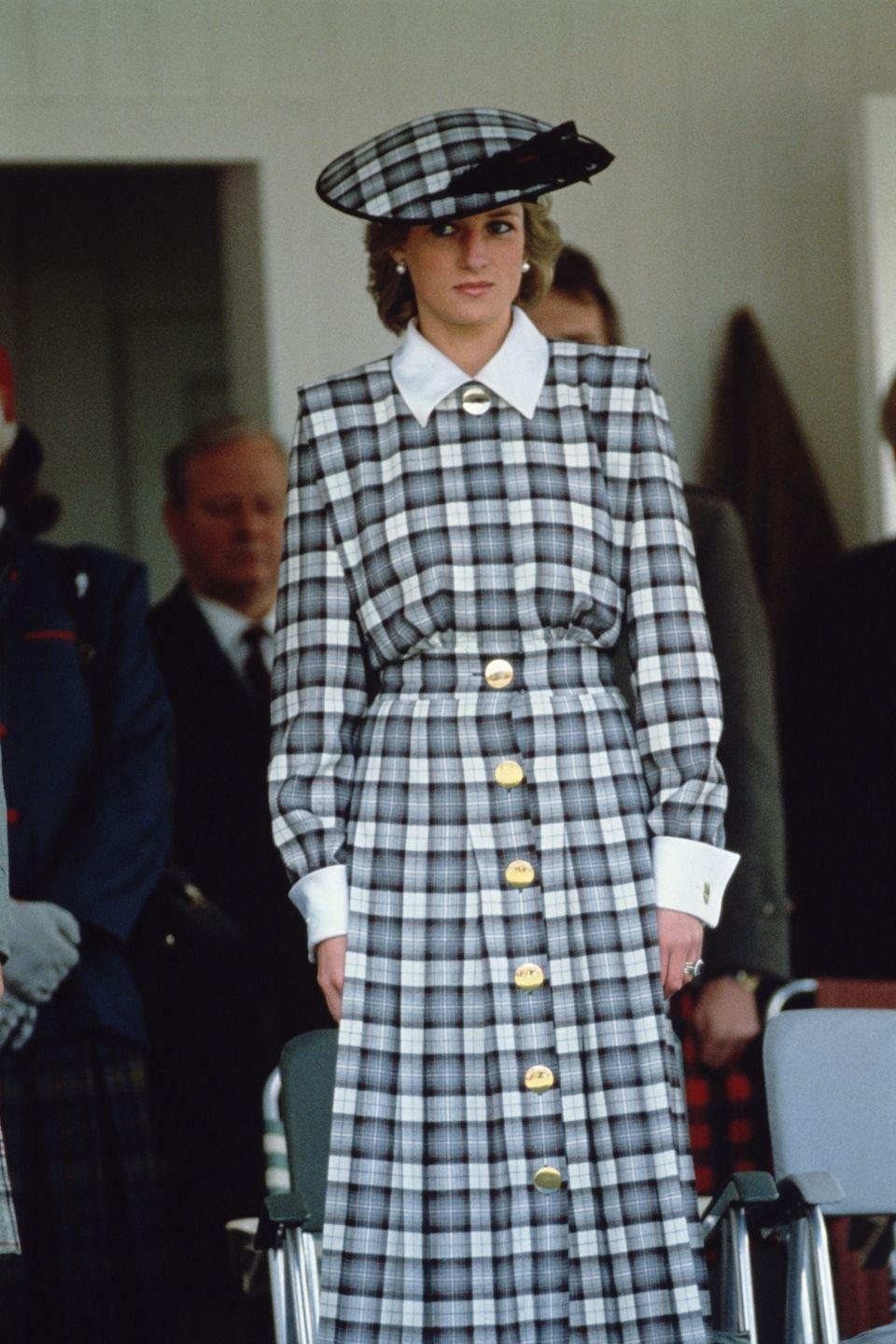 <p>Even when Princess Diana wore more subdued colors, she still went big. Case in point: This matching Catherine Walker hat-and-dress combo she wore to the Braemar Games in Scotland in 1989.</p>