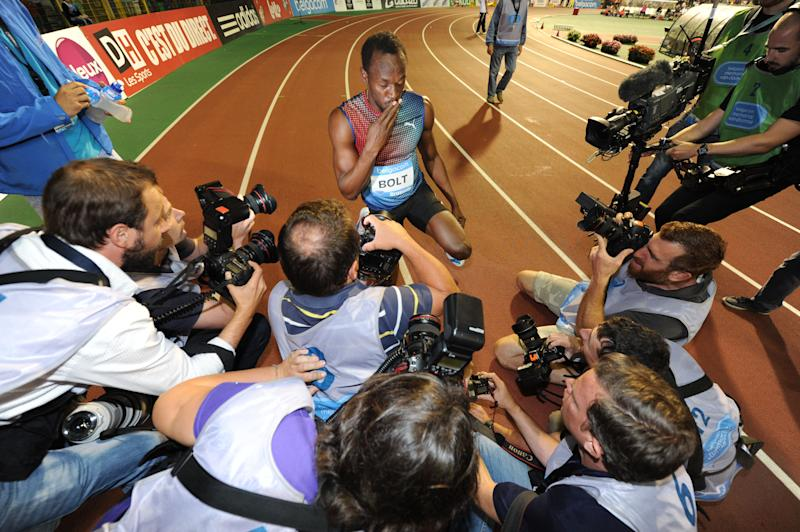Usain Bolt from Jamaica, reacts after he won the men's 100 meters at the Diamond League Memorial Van Damme athletics event, at Brussels' King Baudouin stadium, on Friday, Sept. 6, 2013. (AP Photo/Geert Vanden Wijngaert)