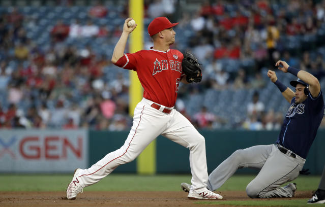 Tampa Bay Rays' Travis d'Arnaud, right, is forced out at second base by Los Angeles Angels third baseman Matt Thaiss on a ground ball from Nate Lowe during the second inning of a baseball game, Saturday, Sept. 14, 2019, in Anaheim, Calif. (AP Photo/Marcio Jose Sanchez)