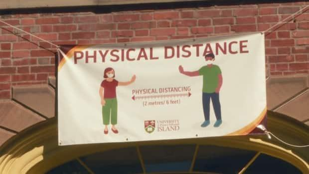 Signs remain up at UPEI to remind those on campus to keep physically distant. (Sheehan Desjardins/CBC - image credit)