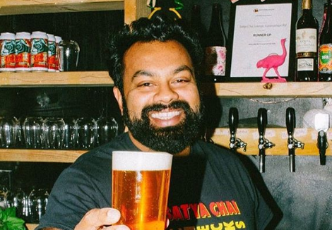 Satya Chai Lounge owner Samrudh Akuthota is pictured holding a beer. Source: Instagram/ Satya Chai Lounge