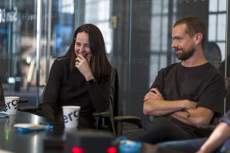 Sarah Friar, chief financial officer of Square Inc., left, laughs as Jack Dorsey, co-founder and chief executive officer of Twitter Inc., listens during an interview in San Francisco, California, U.S., on Thursday, March 2, 2017. Electronic-payment company, Square Inc., run by Dorsey, is offering a range of new services, including loans and software that lets customers manage inventory and analyze sales. Photographer: David Paul Morris/Bloomberg via Getty Images