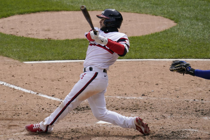 Chicago White Sox's Nick Madrigal hits a two-run triple during the third inning of a baseball game against the Texas Rangers in Chicago, Sunday, April 25, 2021. (AP Photo/Nam Y. Huh)