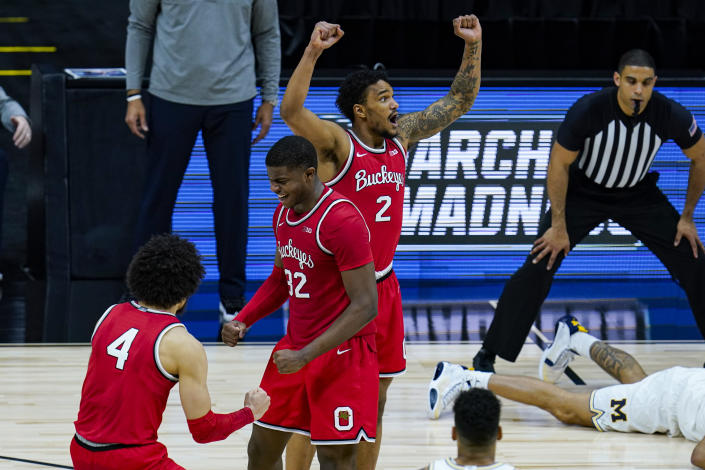 Ohio State's Duane Washington Jr. (4), E.J. Liddell (32) and Musa Jallow (2) celebrate after a 68-67 win over Michigan in an NCAA college basketball game at the Big Ten Conference tournament in Indianapolis, Saturday, March 13, 2021. (AP Photo/Michael Conroy)