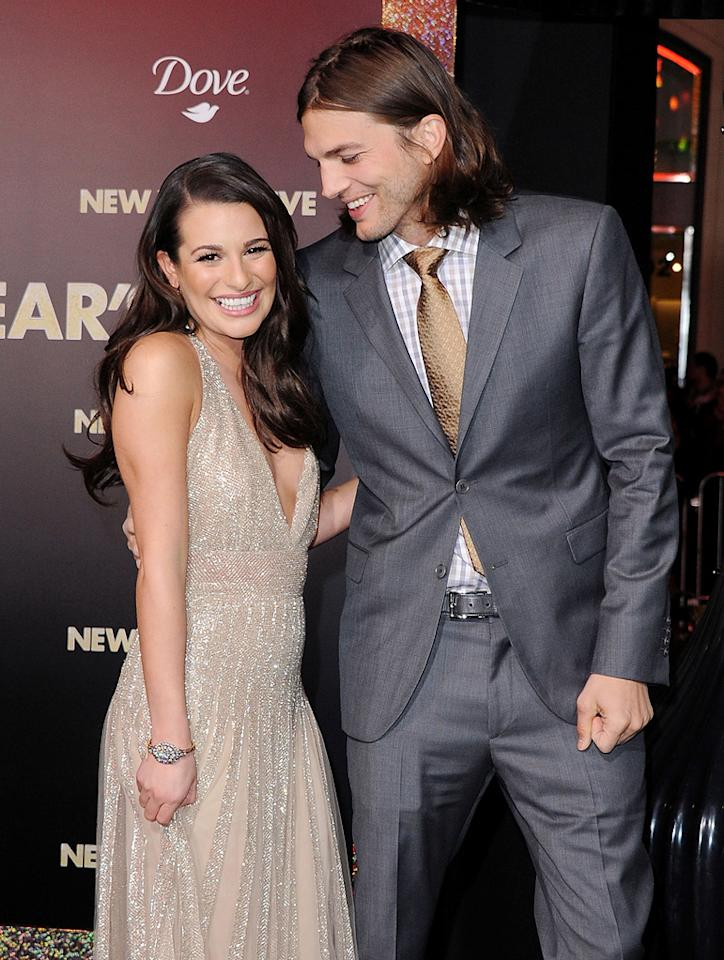 """<a href=""""http://movies.yahoo.com/movie/contributor/1800354733"""">Ashton Kutcher</a>, seen here with co-star <a href=""""http://movies.yahoo.com/movie/contributor/1809577613"""">Lea Michele</a>, hit his very first red carpet since wife <a href=""""http://movies.yahoo.com/movie/contributor/1800012196"""">Demi Moore</a> announced their split in late November at Monday's star-packed premiere of <a href=""""http://movies.yahoo.com/movie/1810219047/info"""">New Year's Eve</a> at Grauman's Chinese Theater in Hollywood. The sharp-dressed Kutcher was seen without his wedding band and the scraggly beard he has been sporting in recent months. Click ahead to see more of the big stars as they arrived at the premiere."""