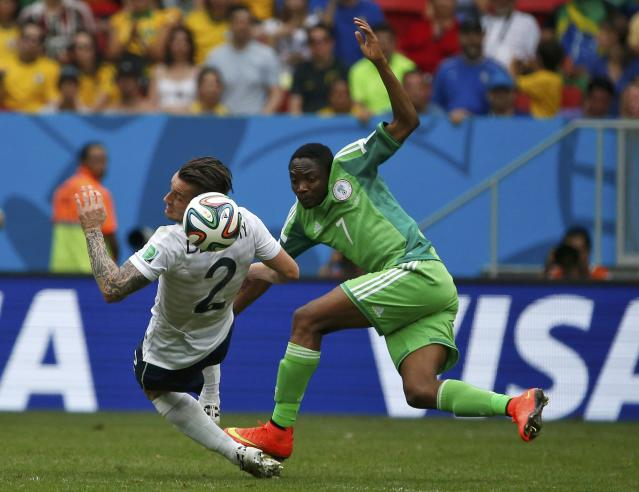 France's Mathieu Debuchy and Nigeria's Ahmed Musa fight for the ball during their 2014 World Cup round of 16 game at the Brasilia national stadium in Brasilia June 30, 2014. REUTERS/Jorge Silva (BRAZIL - Tags: SOCCER SPORT WORLD CUP TPX IMAGES OF THE DAY)
