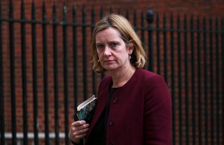 Britain's Home Secretary Amber Rudd leaves 10 Downing Street in London