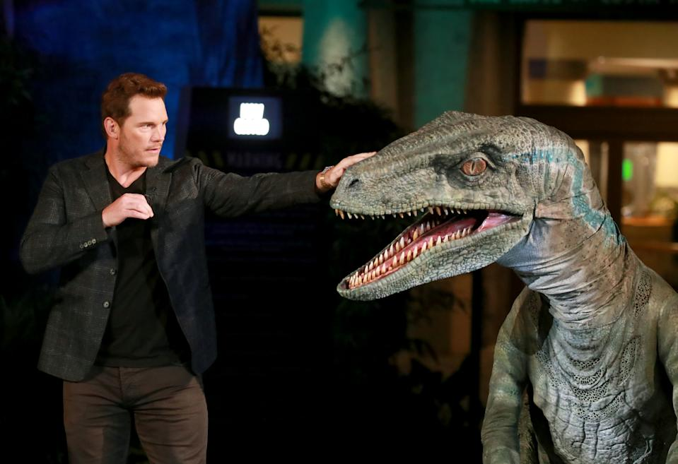 UNIVERSAL CITY, CALIFORNIA - JULY 22: Chris Pratt and Blue the velociraptor interact onstage at the grand opening celebration of 'Jurassic World -The Ride' at Universal Studios Hollywood on July 22, 2019 in Universal City, California. (Photo by Rich Fury/Getty Images for Universal Studios Hollywood )