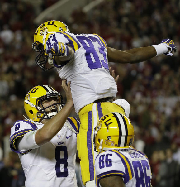 LSU wide receiver Travin Dural (83) celebrates his touch-down catch with LSU quarterback Zach Mettenberger (8) during the first half of an NCAA college football game against Alabama, Saturday, Nov. 9, 2013, in Tuscaloosa, Ala. (AP Photo/Dave Martin)