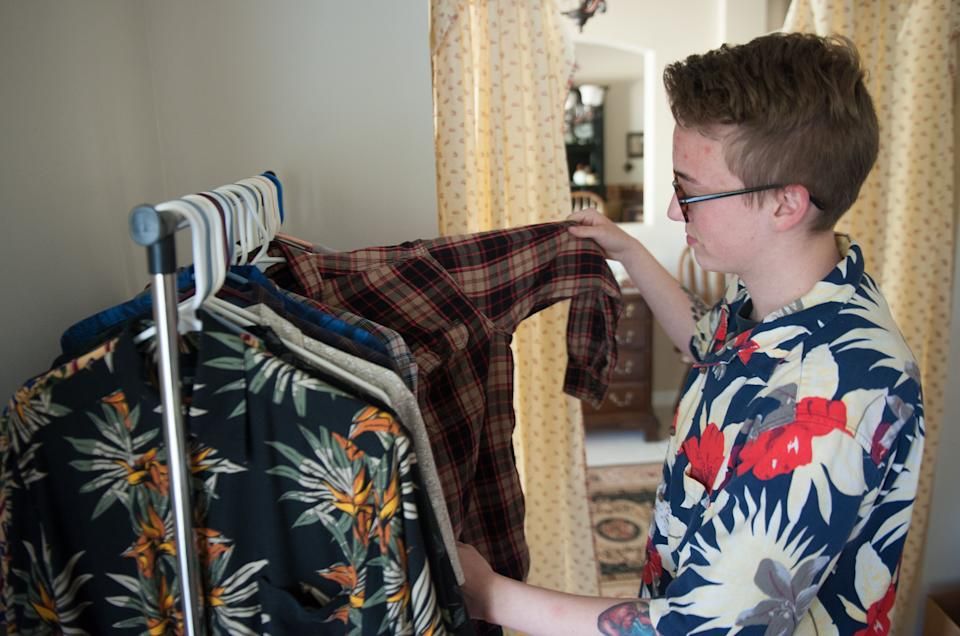 Preston Curts looks through clothes at his home in Ocala, Florida. (Photo: Chris McGonigal/HuffPost)