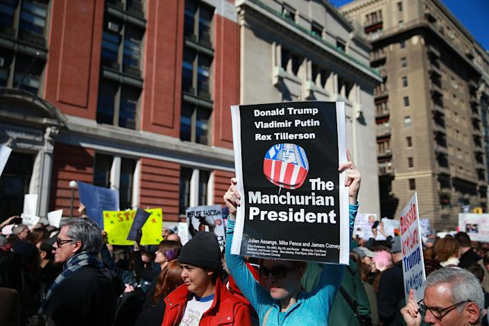 """<p>A demonstrator holds up a sign during the """"Not My President's Day"""" rally on Central Park West in New York City on Feb. 20, 2017. (Gordon Donovan/Yahoo News) </p>"""
