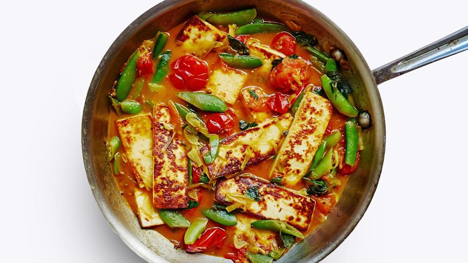 """This dish of seared paneer channels flavors traditionally found in matar paneer—coriander, cumin, chile, and ginger—by incorporating them into a quick-cooking cherry tomato sauce. <a href=""""https://www.epicurious.com/recipes/food/views/paneer-with-burst-cherry-tomato-sauce?mbid=synd_yahoo_rss"""" rel=""""nofollow noopener"""" target=""""_blank"""" data-ylk=""""slk:See recipe."""" class=""""link rapid-noclick-resp"""">See recipe.</a>"""