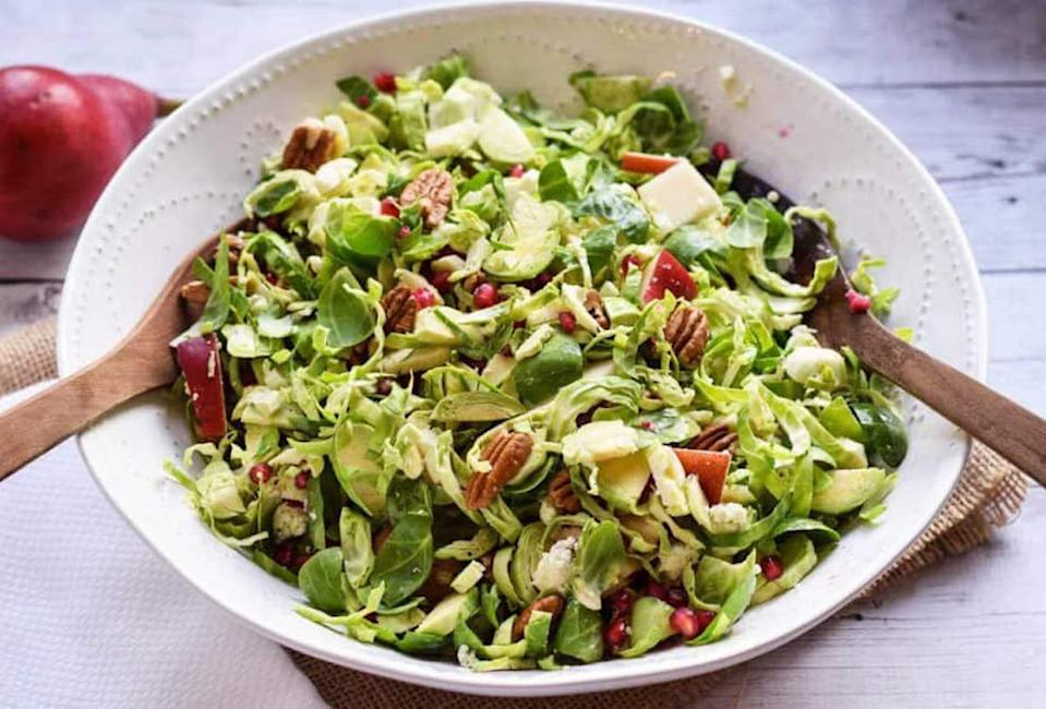 """<p>Sure, Brussels sprouts are great as a stand-alone winter veggie, especially when <a href=""""https://www.thedailymeal.com/recipes/burnt-brussels-sprouts-black-garlic-recipe?referrer=yahoo&category=beauty_food&include_utm=1&utm_medium=referral&utm_source=yahoo&utm_campaign=feed"""" rel=""""nofollow noopener"""" target=""""_blank"""" data-ylk=""""slk:roasted"""" class=""""link rapid-noclick-resp"""">roasted</a>, but they also make a great salad base. Thinly slice the Brussels sprouts to give a salad-like texture, then toss the raw vegetable with diced pears, pomegranate seeds and dressing.</p> <p><a href=""""https://www.thedailymeal.com/recipes/brussels-sprout-salad-pear-and-pomegranate-recipe?referrer=yahoo&category=beauty_food&include_utm=1&utm_medium=referral&utm_source=yahoo&utm_campaign=feed"""" rel=""""nofollow noopener"""" target=""""_blank"""" data-ylk=""""slk:For the Brussels Sprout Salad with Pear and Pomegranate recipe, click here."""" class=""""link rapid-noclick-resp"""">For the Brussels Sprout Salad with Pear and Pomegranate recipe, click here.</a></p>"""