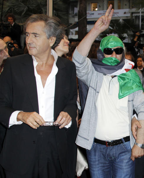 Director Bernard-Henry Levy, left, arrives for the screening of The Oath of Tobruk at the 65th international film festival, in Cannes, southern France, Friday, May 25, 2012. (AP Photo/Joel Ryan)