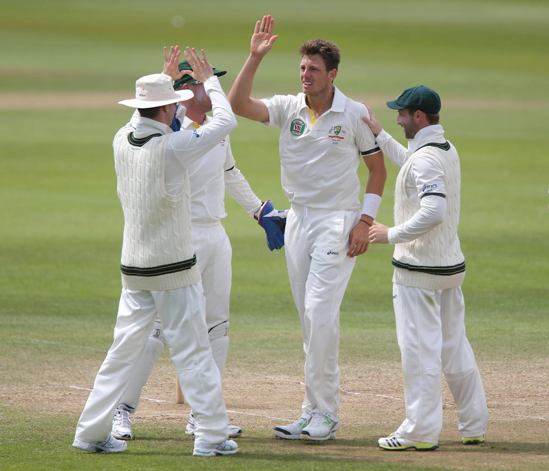 Australian's James Pattinson (centre) celebrates after trapping Somerset batsman Chris Jones , during the International Tour match at the County Ground, Taunton.