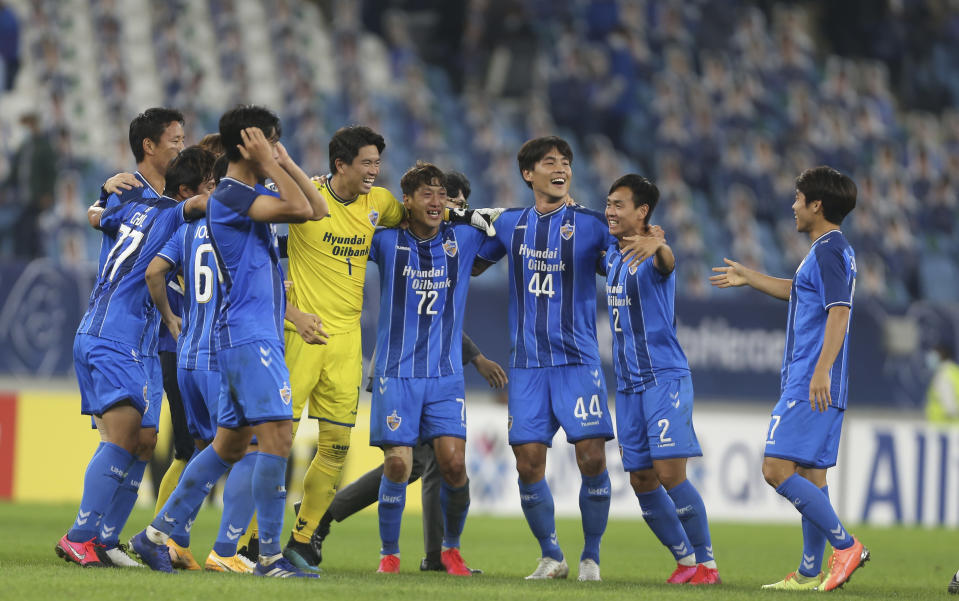 FILE - In this Dec. 19, 2020 file photo, Ulsan Hyundai's players celebrate after the AFC Champions League final match against Persepolis in Al Wakrah, Qatar. The Asian Champions League's eastern zone competition will finally kick off after a series of delays and withdrawals. But the troubled tournament has a different look to previous editions of the continental club championship. (AP Photo/Hussein Sayed, File)