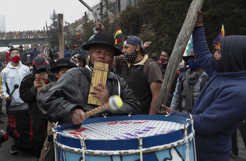 Musicians play during a protest against the postponement of the presidential election, in El Alto, Bolivia, Tuesday, Aug. 11, 2020. Citing the ongoing new coronavirus pandemic, Bolivia's highest electoral authority delayed presidential elections from Sept. 6 to Oct. 18, the third time the vote has been delayed. (AP Photo/Juan Karita)