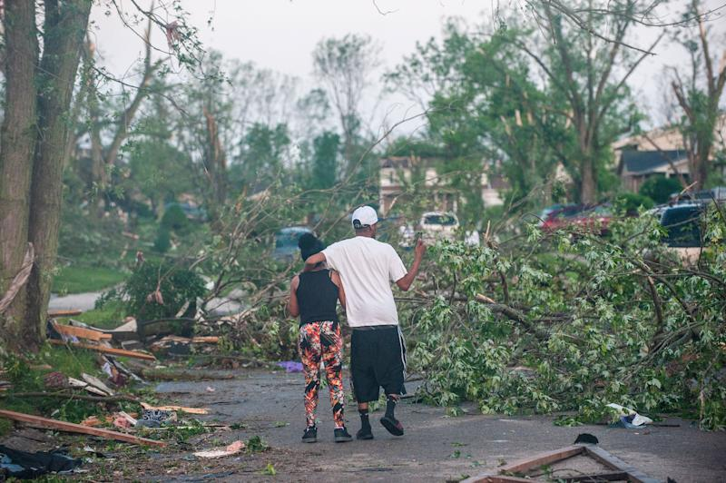 Residents of the West Brook neighborhood in Trotwood, Ohio, inspect the damage to their homes on May 28. (Photo: Matthew Hatcher/Getty Images)
