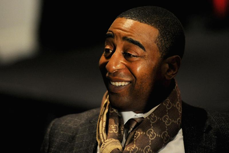 Cris Carter, former NFL player, and current ESPN analyst, talks with reporters during the ESPN media availablility in the Empire West Ballroom, at Super Bowl XLVIII Media Center at the Sheraton New York Times Square on January 28, 2014 in New York
