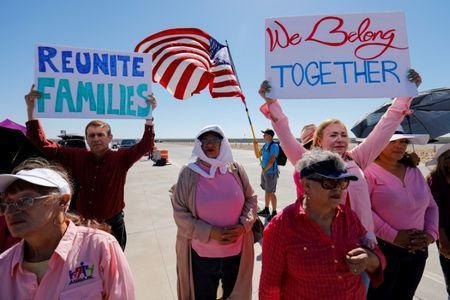 """FILE PHOTO: A small group of demonstrators protests outside of the children's tent encampment built to deal with the Trump administrations """"zero tolerance"""" policy in Tornillo, Texas, U.S. June 21, 2018. REUTERS/Mike Blake/File Photo"""