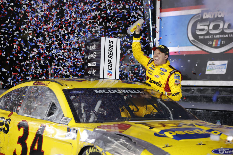 DAYTONA BEACH, FLORIDA - FEBRUARY 14: Michael McDowell, driver of the #34 Love's Travel Stops Ford, celebrates in victory lane after winning the NASCAR Cup Series 63rd Annual Daytona 500 at Daytona International Speedway on February 14, 2021 in Daytona Beach, Florida. (Photo by Jared C. Tilton/Getty Images)
