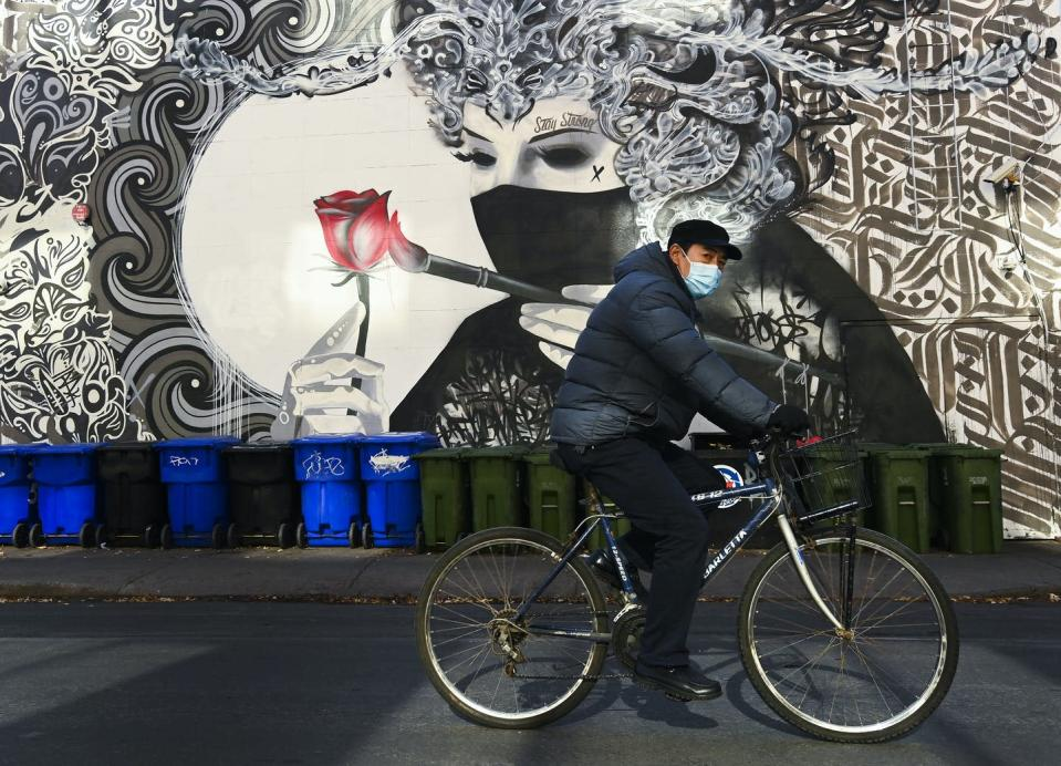 """<span class=""""caption"""">The COVID-19 pandemic has seen an increase in people cycling as an alternative to public transit. </span> <span class=""""attribution""""><span class=""""source"""">THE CANADIAN PRESS/Nathan Denette</span></span>"""