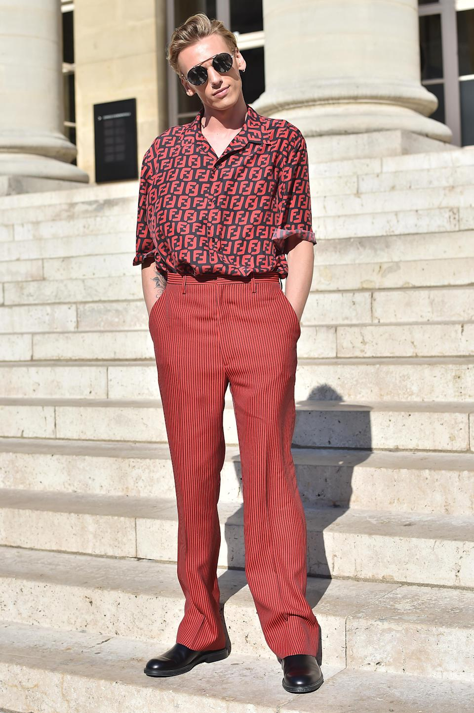 <p>Jamie Campbell Bower chose a co-ordinating Fendi combo for the label's haute couture show on 4 July in Paris. <em>[Photo: Getty]</em> </p>