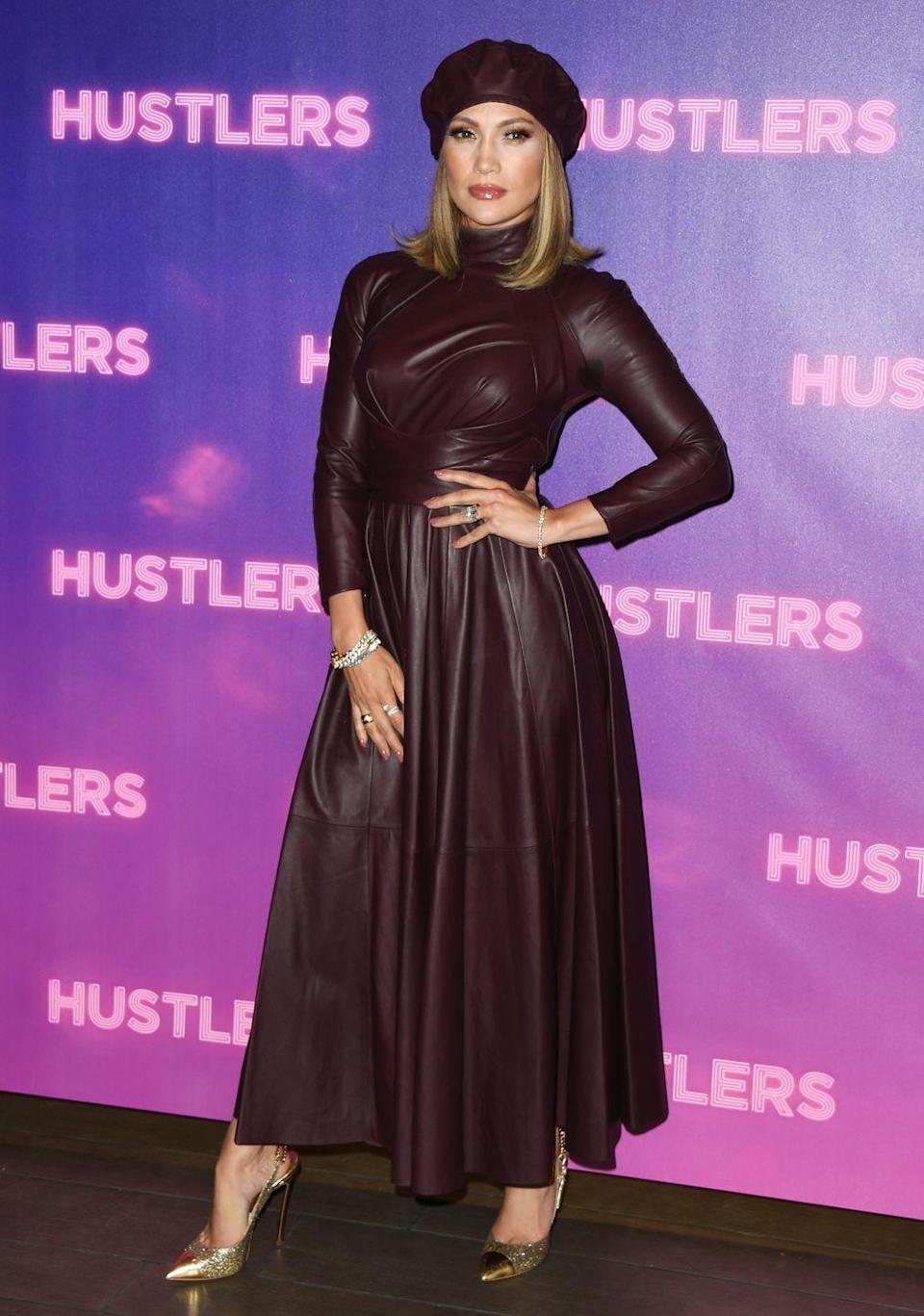 <p>J.Lo wears this burgundy leather getup with a matching beret and metallic gold heels at a photo call for <em>Hustlers</em> in Los Angeles. </p>