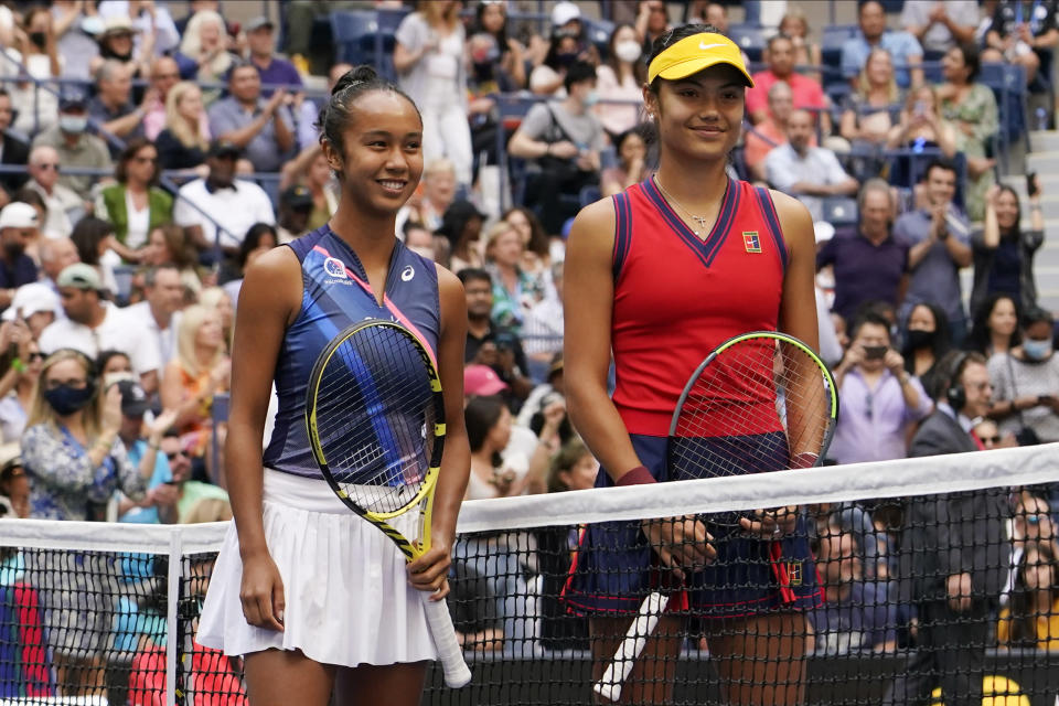 Leylah Fernandez, of Canada, left, and Emma Raducanu, of Britain, pose for a photo before playing in the women's singles final of the US Open tennis championships, Saturday, Sept. 11, 2021, in New York. (AP Photo/Elise Amendola)