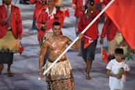 """<p>Taufatofua <a href=""""https://people.com/sports/shirtless-tonga-flag-bearer-at-olympic-opening-ceremony/"""" rel=""""nofollow noopener"""" target=""""_blank"""" data-ylk=""""slk:first went viral"""" class=""""link rapid-noclick-resp"""">first went viral</a> for his shirtless, oiled-up look at the 2016 Olympics. (Ah, 2016, a simpler time!)</p>"""