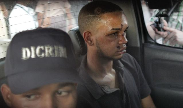 Eddy Vladimir Féliz Garcia, in custody in connection with the shooting of former Boston Red Sox slugger David Ortiz, is transferred by police to court in Santo Domingo, Dominican Republic, Tuesday, June 11, 2019. His lawyer, Deivi Solano, said Féliz Garcia had no idea who he'd picked up and what was about to happen, and that he expected Féliz Garcia would be charged as an accomplice to an attempted murder. (AP Photo/Roberto Guzman)