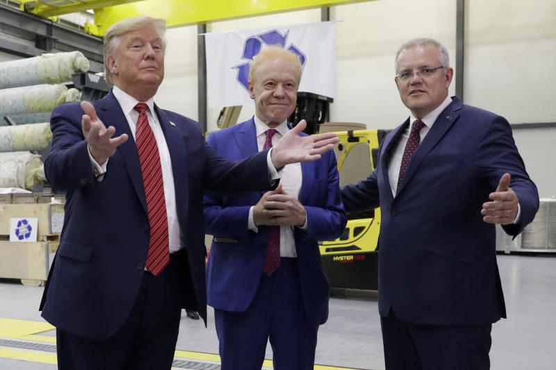 President Donald Trump and Australian Prime Minister Scott Morrison speak as Pratt Industries chairman Anthony Pratt, center, watches during a tour of Pratt Industries, Sunday, Sept 22, 2019, in Wapakoneta, Ohio. (AP Photo/Evan Vucci)