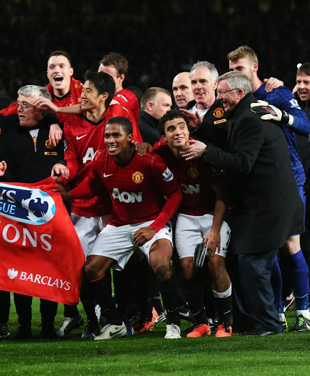 MANCHESTER, ENGLAND - APRIL 22: Phil Jones, Shinji Kagawa, Antonio Valencia, Rafael and manager Sir Alex Ferguson of Manchester United celebrate winning the Premier League title after the Barclays Premier League match between Manchester United and Aston Villa at Old Trafford on April 22, 2013 in Manchester, England. (Photo by Alex Livesey/Getty Images)